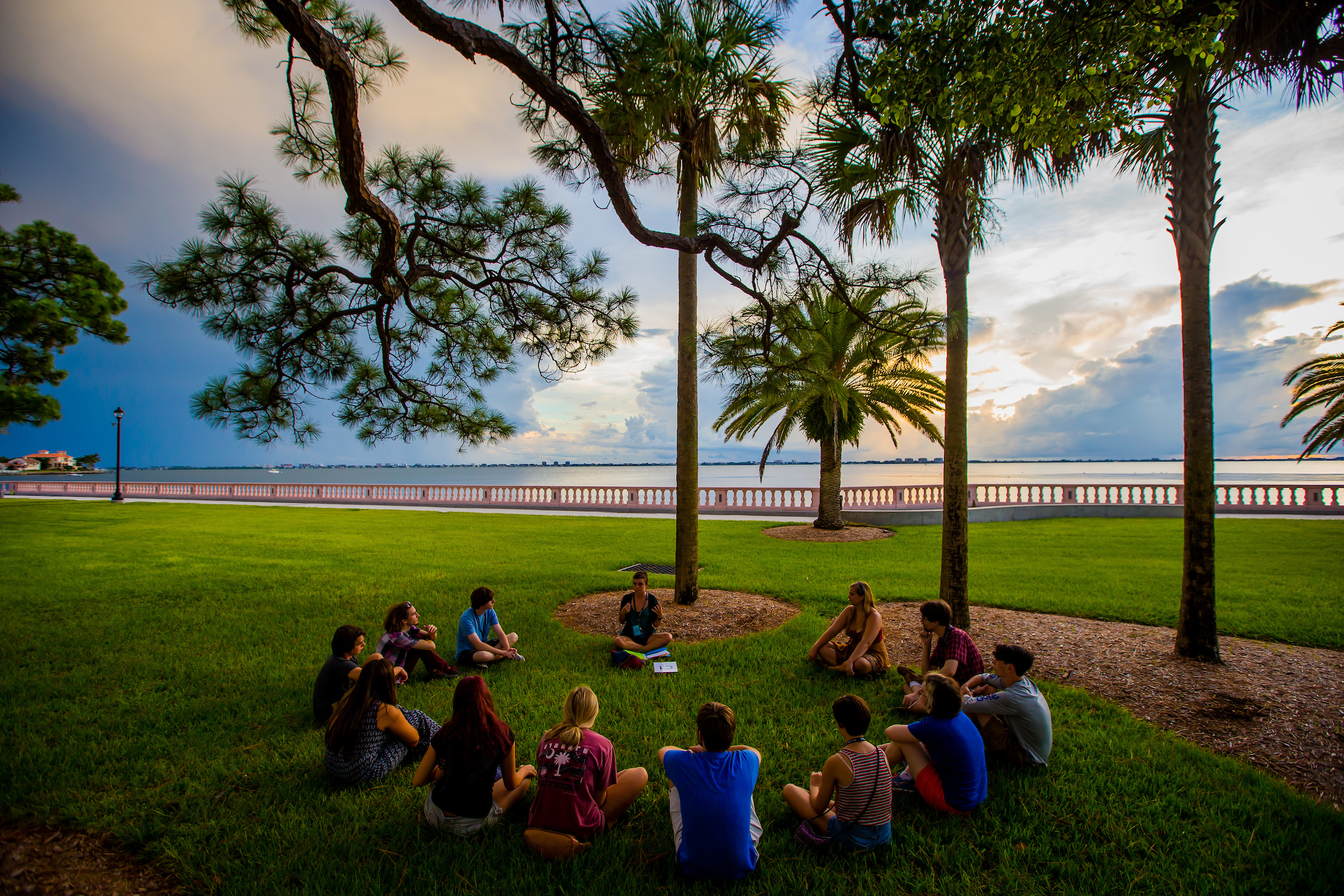 SARASOTA, FL - August 15, 2015 -- Students, parents, and alumni gather at sunset along the bayfront during orientation weekend at New College of Florida for the 2015-2016 academic year.  (PHOTO / CHIP LITHERLAND)